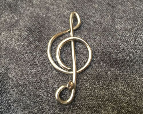 Clive's Music badge/brooch