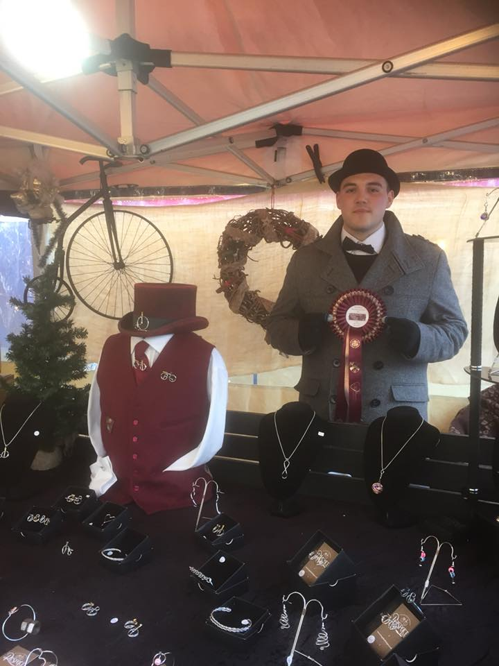 Jamie holding ribbon for 3rd place Best dressed stall at Stratford Upon Avon Christmas Fayre 2017